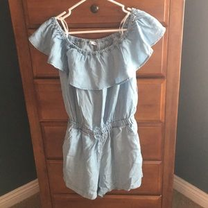 Off the shoulder romper with opening in back.